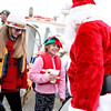 Marblehead: December 5, 2009: Santa and Mrs. Claus arrive at State Street in Marblehead from a lobster boat hailing from the North Pole as throngs of children gather to greet them.  Photo by Liz Curtis