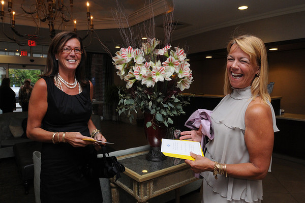 "Salem:<br /> Carol MacDonald, left, and Rosemary Crosby, both of Marblehead, look at their shuttle ticket upon entering the Salem Waterfront Hotel, which is the starting point for the North Shore Mystery Dine Around"" dinner to benefit the North Shore Cancer Walk. The people were served cocktails and Hors d'oeuvres at the Regatta Pub before traveling to a ""mystery restaurant.<br /> Photo by Ken Yuszkus/Salem News, Friday,  September 10, 2010."