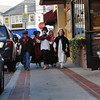 "Marblehead: From left, Ben Hanna, 9, Lucia Beurer, 8, Cameron Saltsman, 9 Maddy Lowy, 8, and Harriet Langburd, 9 take a stroll down School Street as characters from ""A Christmas Carol"". photo by Mark Teiwes / Salem News"