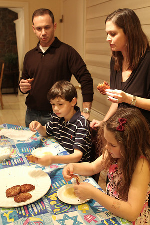 Marblehead: Greg Mogolesko and his wife, Ilana and their children Max and Arielle, enjoy Latkes.