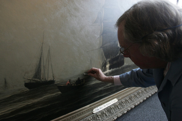 "Peter Williams of the Peter Williams Museum Services is working to restore Marblehead painting ""Crossing the Grand Banks"" by William Edward Norton. The painting dates from 1800s, and is being restored while its home, the selectman's meeting room at Abbot Hall, is renovated. photo by deborah parker/october 28, 2010"