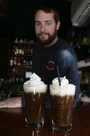 Dan Rand, a bartender at the Barnacle in Marblehead, presents their Irish Coffee. Photo by deborah parker/november 3, 2010