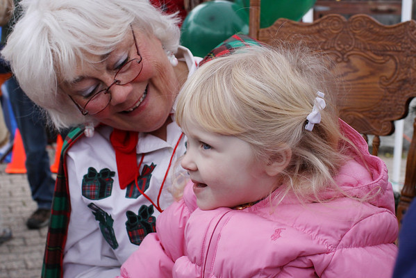 Marblehead: Santa and Mrs. Claus arrive at State Street in Marblehead from a lobster boat hailing from the North Pole as throngs of children gather to greet them.  Isabel Hunt of Marblehead is thrilled to have some time to chat with Mrs. Claus.  Photo by Liz Curtis
