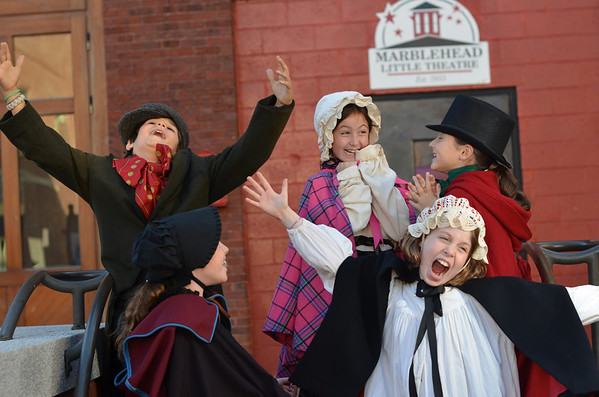 "Marblehead: First row from left, Lucia Beurer, 8, Harriet Langburd, 9; second row, Ben Hanna, 9, Maddy Lowy, 8, and Cameron Saltsman, 9, are members of Marblehead Little Theater dressed as characters from ""A Christmas Carol"". photo by Mark Teiwes / Salem News"
