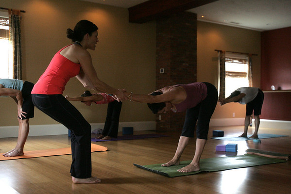 Yoga instructor Willa Worsford helps student Nancy Sheena Sarlus of Marblehead work through a pose during a PranaVayu yoga class held at the Yoga Loft in Marblehead. Photo by deborah parker/october 26, 2010