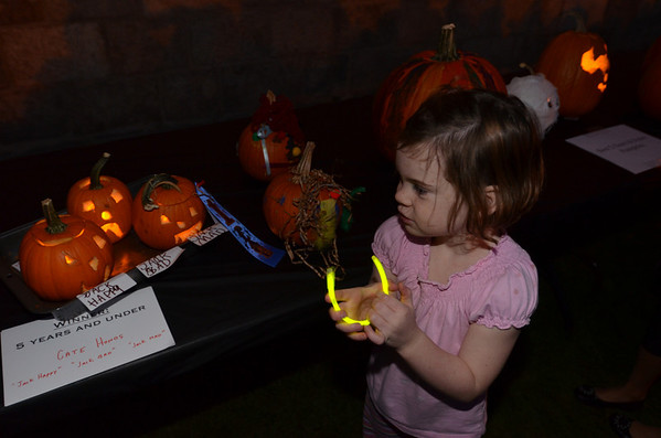 "Marblehead: Cate Honos ,5, of Marblehead, won first place in the five years and under category at this year's ""Pumpkin Illumination"" with three small pumpkins she made and named Jack Happy, Jack Sad, and Jack Mad.  photo by Mark Teiwes"