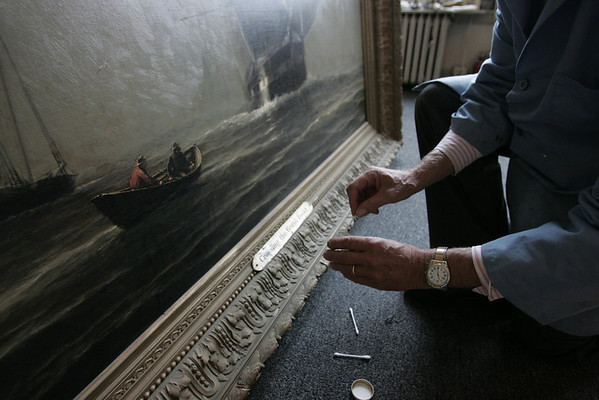 """Peter Williams of the Peter Williams Museum Services is working to restore Marblehead painting """"Crossing the Grand Banks"""" by William Edward Norton. The painting dates from 1800s, and is being restored while its home, the selectman's meeting room at Abbot Hall, is renovated. photo by deborah parker/october 28, 2010"""