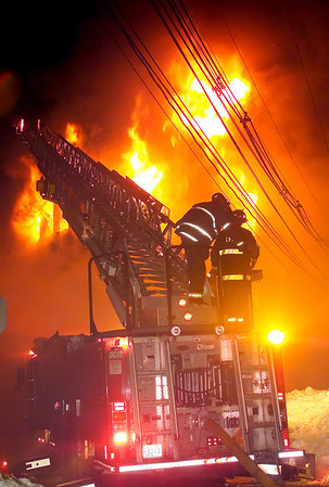 Marblehead: Lynn fire department Ladder-1 operates a ladder-pipe at the front of Tony's Pizza on School Street during a 4 alarm fire early this morning.  (Photo by Jim Daly/Salem News). Thursday, February 20, 2003 (NOTE: THIS IS A DIGITAL CAMERA IMAGE).<br /> **************************************<br /> Filter: Min (QMPro: Red Radius:0/Blue Radius:6/No Desp.)<br /> USM: Strong (Amt:300/Radius:0.3/Thresh:2)<br /> File Size: 10.3MB<br /> Original file name: 9B233999.TIF