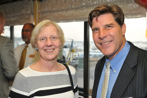 From left, Marsha Christensen, president of the Marblehead Rotary Club, and Jim Nye of National Grand Bank.  photo by Mark Teiwes / Salem News