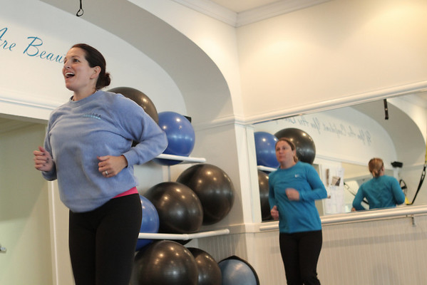 Marblehead: Kathy Glabicky owner of Chakra personal training, leads an exercise.