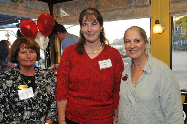 From left, Cathy Gallagher and Darlene Currier of Eastern Bank, and Carol Moore owner of Shipshape attended the Marblehead Chamber of Commerce's 58th Annual Meeting at The Landing Restaurant.  photo by Mark Teiwes / Salem News