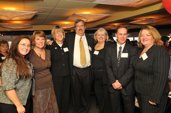 From left, Marblehead Bank employees Julie Haskell, Marcia Lewis, Merrill Belmer, Bud and Julie Livingston, Mark Llewellyn. and Diane Rossini.   Julie Livingston was named the 2010 Rey Moulton person of the year by the Marblehead Chamber of Commerce.  photo by Mark Teiwes / Salem News