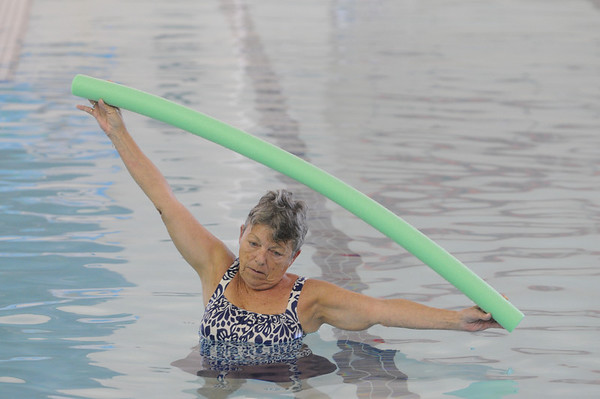 Marblehead:<br /> Melody Worthley uses a noodle float during the water aerobics class instructed by Cheryl Verrette at the Marblehead YMCA on Thursday morning.<br /> Photo by Ken Yuszkus/Salem News, Thursday,  October 28, 2010.