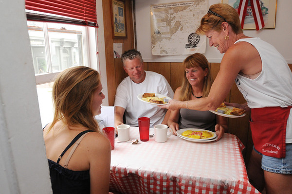 Marblehead:<br /> Jan Frost, right, waitress, serves breakfast to, from left, Margo Blagden, Jamie Noyes, and Beverly Blagden, all of Marblehead, at the Driftwood restaurant.<br /> Photo by Ken Yuszkus/Salem News, Friday August 6, 2010.