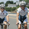 Husband and wife, Marti Shea and Joe Tonon, who train riders, cycle on the Causeway towards Marblehead Neck. Photo by Deborah Parker/July 27, 2010