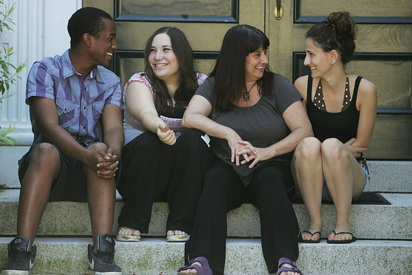 Keri Cahill, of Marblehead, founder of the Shakespeare Co., jokes around with several of her student actors, Jabar Itovar of Salem, Madeline Goldberg and Emilie Soghomonian all of Marblehead, while in front of the Unitarian Universalist Church in Marblehead. Photo by Deborah Parker/June 28, 2010