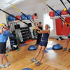 Marblehead: At Energy Within Lisa Gillis, center, trains a group in TRX suspension systems.  Janine Leach of Swampscott, right, leans back for an upper body workout.<br /> photo by Mark Teiwes