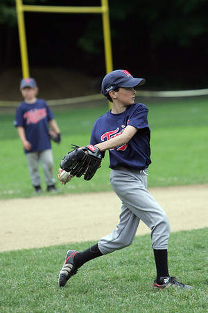 Twin's player Hutch Myers throws to first during a warm up at Gatchell's Park in Marblehead before a little league game between the Twins and the Angels. Photo by Deborah Parker/June 17, 2010