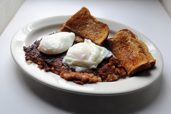 Marblehead:<br /> This a specialty breakfast dish at the Driftwood restaurant. Corned beef hash with poached eggs, although you can have the eggs in different styles.<br /> Photo by Ken Yuszkus/Salem News, Friday August 6, 2010.