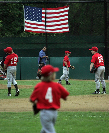 The Angel's warm up between innings during a game against the Twins held at Gatchell's Park in Marblehead. Photo by Deborah Parker/June 17, 2010