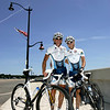 Husband and wife, Marti Shea and Joe Tonon, who train riders, cycle around Marblehead Neck. Photo by Deborah Parker/July 27, 2010