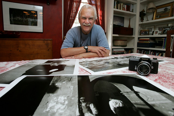 John and Jean Fogle are visible members of the arts and culture community on the North Shore. John is Artistic Director of the Salem Theatre Company,  an actor and is also a photographer.  Jean, his wife, is a painter. Here John displays some ove his photographs that will be part of an upcoming show. Photo by Deborah Parker/July 20, 2010