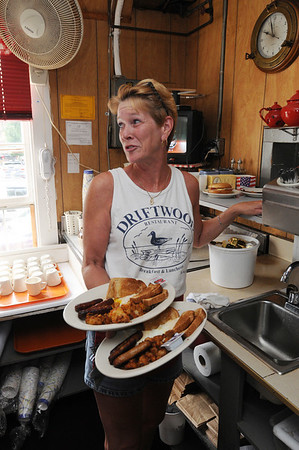 Marblehead:<br /> Jan Frost, waitress, balances full plates destined to customers for breakfast as she waits for the last dish from the cook to complete the order at the Driftwood restaurant.<br /> Photo by Ken Yuszkus/Salem News, Friday August 6, 2010.