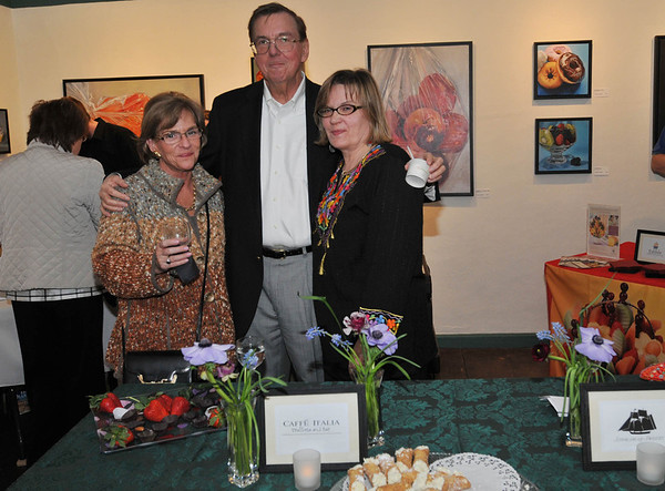 Marblehead: From left, Cheri and John Garrett of Marblehead, and Julie Rose of Salem.  The Artful Palate - Marblehead Arts Association fundraiser  photo by Mark Teiwes / Salem News