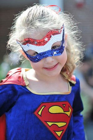 Marblehead: Katie Pyne, 5, of Marblehead dressed as super woman for the Horrible's parade     photo by Mark Teiwes