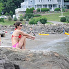 Marblehead:  Ariana Bates relaxes on the rocks above Grace Oliver Beach. photo by Mark Teiwes