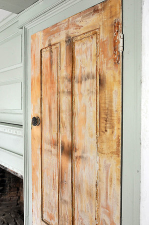 Marblehead: A closet door has ben scraped and read for repainting