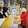 Marblehead:  Marie Adams talks with Carol Shube inside Shubie's Marketplace.