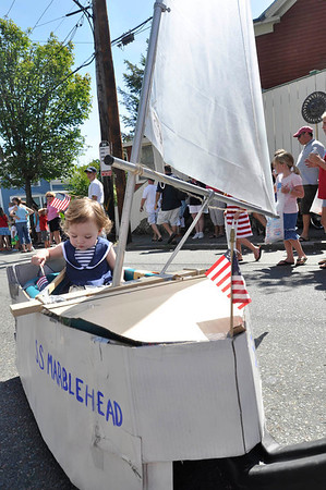 Marblehead:  Piper Russo, 2, of Marblehead, sails down the street.     photo by Mark Teiwes