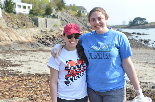 Marblehead: Alea Moscone, 15, left, and Zoe Golub-Sass, 16 spent a Saturday monring cleaning up Gas House Beach.  Mark Teiwes / Salem News