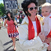 Marblehead: Father and son Elvises, Mike Weed and his son Eben, 1, of Marblehead MH march down the street.    photo by Mark Teiwes