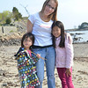 Marblehead: Anathea Waitekus and her daughters Song, 5, left, and Asia, 8, helped pick up trash for a beach cleanup day.  Mark Teiwes / Salem News