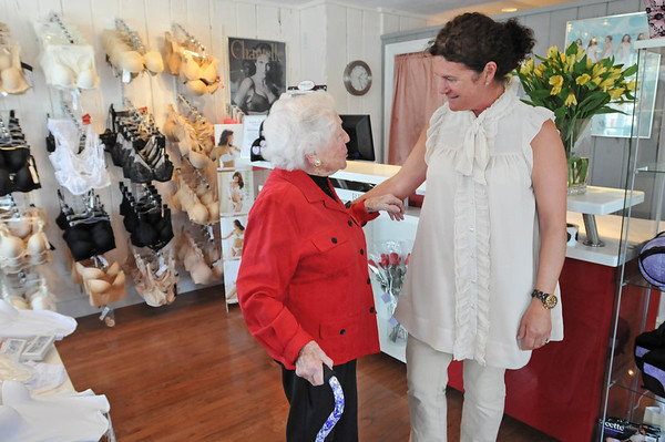 "Marblehead: Marie Adams, left, stops by Arabella Lingerie everyday to bring the newspaper and talk to owner Elisabeth Steinfeld.  Marie also helps decorate the windows and store, which she calls ""the best underwear store in Essex County"".  photo by Mark Teiwes"