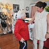 """Marblehead: Marie Adams, left, stops by Arabella Lingerie everyday to bring the newspaper and talk to owner Elisabeth Steinfeld.  Marie also helps decorate the windows and store, which she calls """"the best underwear store in Essex County"""".  photo by Mark Teiwes"""