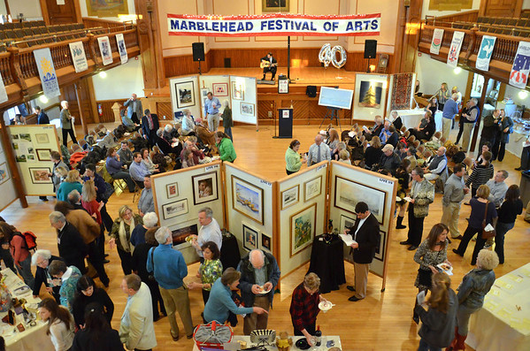 Attendees browse the art on sale at the Marblehead Festival of Arts annual Art Auction in Abbot Hall.