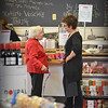 Marblehead:  Marie Adams talks with Carol Shube inside Shubie's Marketplace.