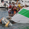 Marblehead:<br /> Bobbie Segee rights the sailboat after deliberately capsizing it in Marblehead harbor at the Boston Yatch Club. The exercise was a test to join the Boston Yatch Club Junior Sailing Program. <br /> Photo by Ken Yuszkus/Salem News, Monday, June 28, 2010.