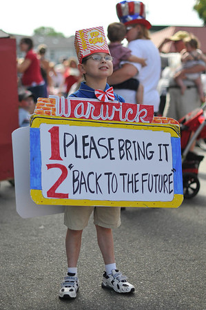 Marblehead: Jake Moore, 10, of Marblehead, is dressed as the Warwick Theater sign for Horrible's parade     photo by Mark Teiwes