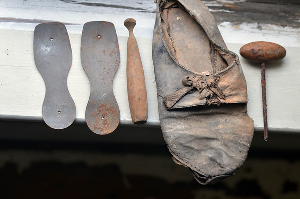 Marblehead: A shoe and coblers tools were found above the lathe.