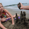 Mablehead: Madison Bates, 9, works on a sand castle at Devereaux Beach. photo by Mark Teiwes