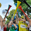 Marblehead: The World Cup comes to Marblehead as Ellie Gransbury, left,  6, of Marblehead, holds up a trophy while kids blow Vuvuzela horns.    photo by Mark Teiwes