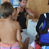 Marblehead:<br /> Geoff England, one of the optimistic racing coaches, explains technique to the young sailors at the Pleon Yatch Club.<br /> Photo by Ken Yuszkus/Salem News, Tuesday, July 13, 2010.