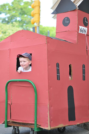 Marblehead: Cooper Dalferro, 3, of Lynn, peaks outside of a Abbott Hall replica for Marblehead Horrible's parade     photo by Mark Teiwes