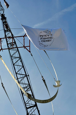 Marblehead:   A flag hangs on the crane at Marblehead Trading Company for Pete's Fishing Derby, an annual contest honoring the late Peter Gamble.  photo by Mark Teiwes
