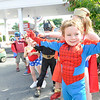 Marblehead: Mick McCormick, 4, of Marblehead, shows of his spider sense with other super heros behind him.    photo by Mark Teiwes