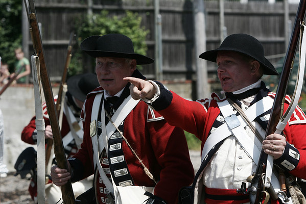 Reenactors battle for Fort Sewall as part of Glovers Regiment encampment at the Fort this weekend. The event included two battles for the Fort against the British along with camp tours and demoonstrations. Photo by Deborah Parker/July 11, 2009